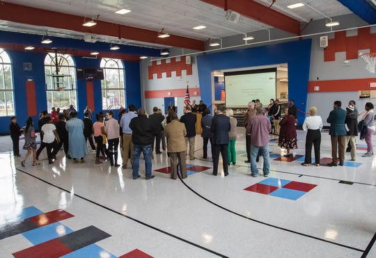 People gather in the new gymnasium at Barkdull Faulk Elementary in Monroe, La. on March 7. Parts of the existing building were renovated and a new combination cafeteria-auditorium-gymnasium, called a cafetorium, were built using funds from a capital improvement bond passed in 2013.
