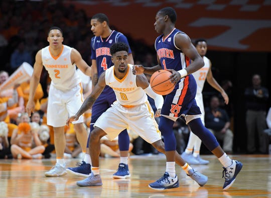 Tennessee guard Jordan Bone (0) defends Auburn guard Jared Harper (1) during the first half at Thompson-Boling Arena on Jan. 2, 2018, in Knoxville, Tennessee.