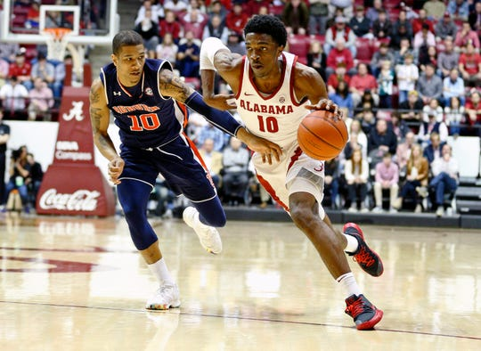 Mar 5, 2019; Tuscaloosa, AL, USA; Alabama Crimson Tide guard Herbert Jones (10) drives to the basket against Auburn Tigers guard Samir Doughty (10) during the second half at Coleman Coliseum. Mandatory Credit: Marvin Gentry-USA TODAY Sports