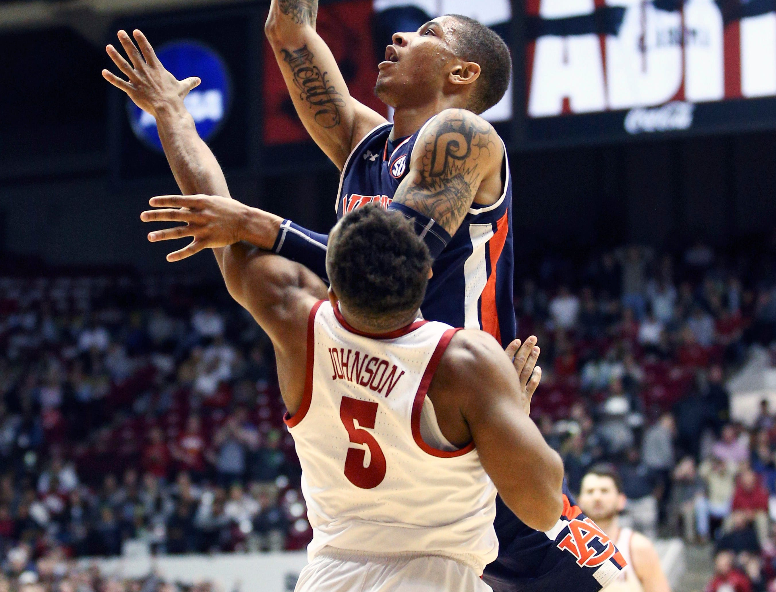Mar 5, 2019; Tuscaloosa, AL, USA; Auburn Tigers forward Danjel Purifoy (3) goes to the basket as Alabama Crimson Tide guard Avery Johnson Jr. (5) defends during the first half at Coleman Coliseum. Mandatory Credit: Marvin Gentry-USA TODAY Sports