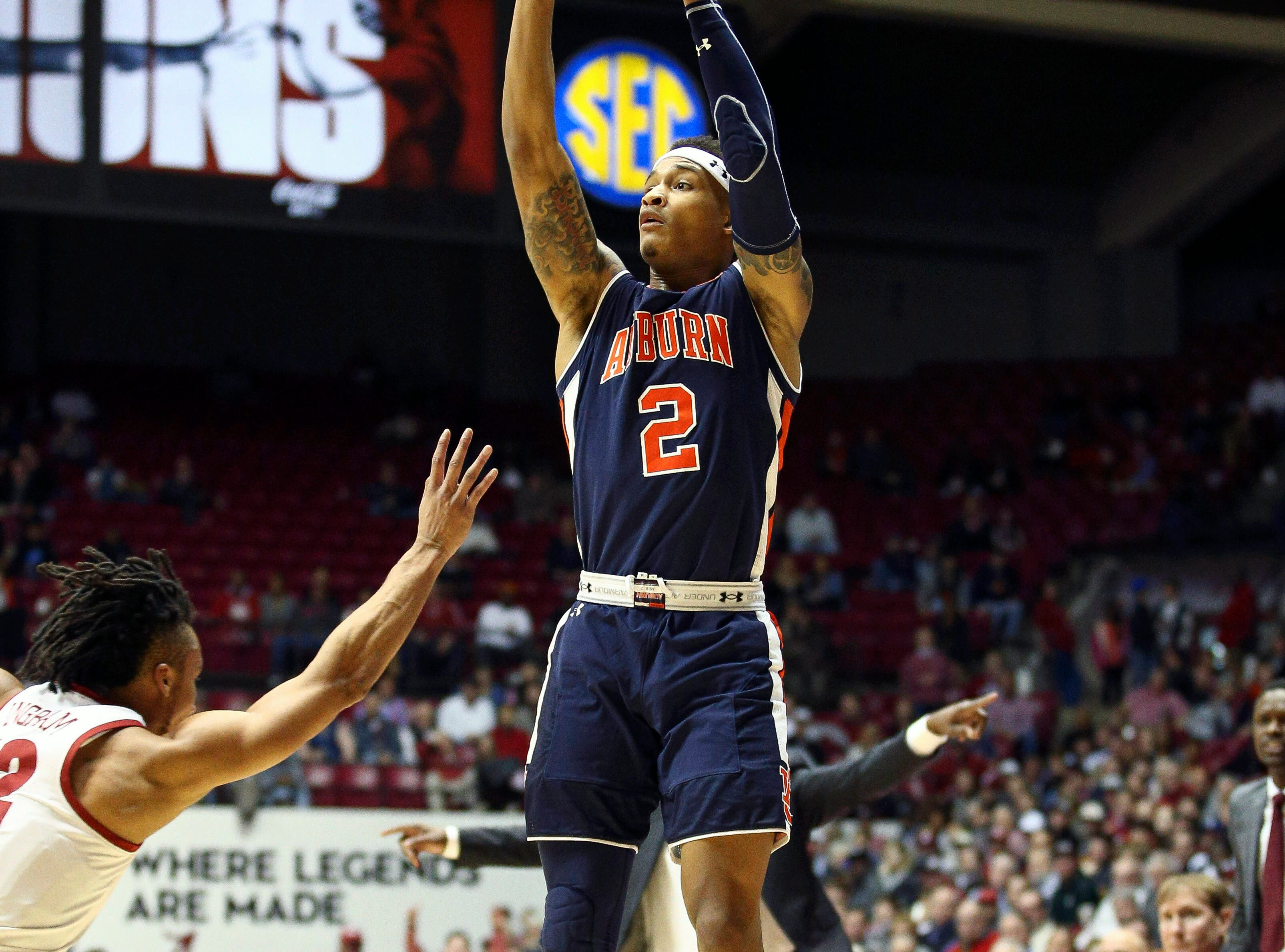 Mar 5, 2019; Tuscaloosa, AL, USA; Auburn Tigers guard Bryce Brown (2) shoots against Alabama Crimson Tide guard Dazon Ingram (12) during the first half at Coleman Coliseum. Mandatory Credit: Marvin Gentry-USA TODAY Sports