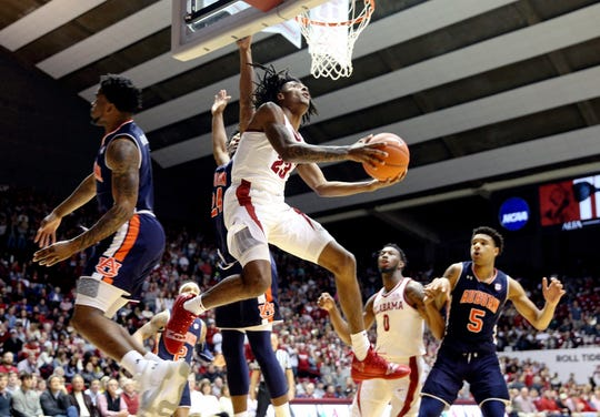 Mar 5, 2019; Tuscaloosa, AL, USA; Alabama Crimson Tide guard John Petty (23) goes to the basket against Auburn Tigers forward Anfernee McLemore (24) during the second half at Coleman Coliseum. Mandatory Credit: Marvin Gentry-USA TODAY Sports