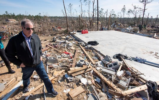Sen. Doug Jones tours tornado damage in Beauregard, Ala., on Thursday March 7, 2019. A fatal tornado struck Beauregard on Sunday afternoon.
