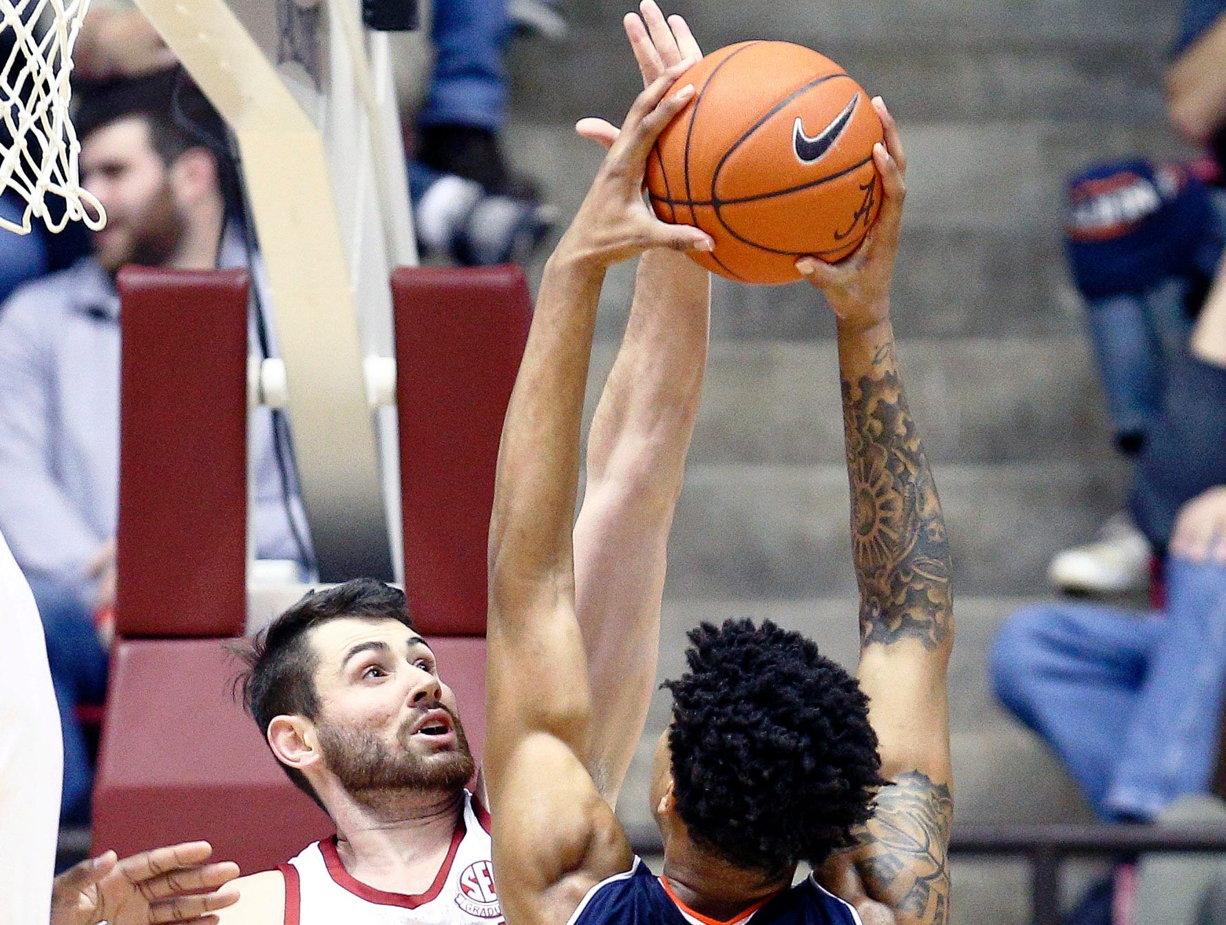 Mar 5, 2019; Tuscaloosa, AL, USA; Alabama Crimson Tide guard Riley Norris (1) goes up to block the shot of Auburn Tigers forward Chuma Okeke (5) during the second half at Coleman Coliseum. Mandatory Credit: Marvin Gentry-USA TODAY Sports