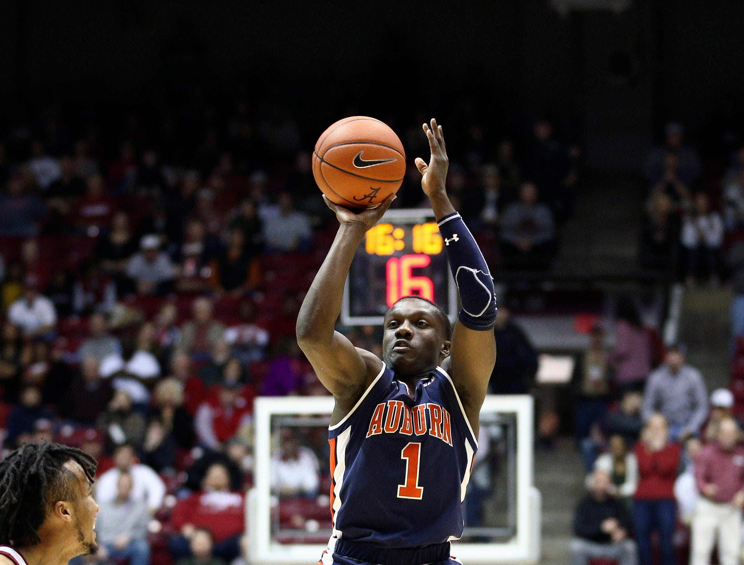 Mar 5, 2019; Tuscaloosa, AL, USA; Auburn Tigers guard Jared Harper (1) shoots against Alabama Crimson Tide during the first half at Coleman Coliseum. Mandatory Credit: Marvin Gentry-USA TODAY Sports