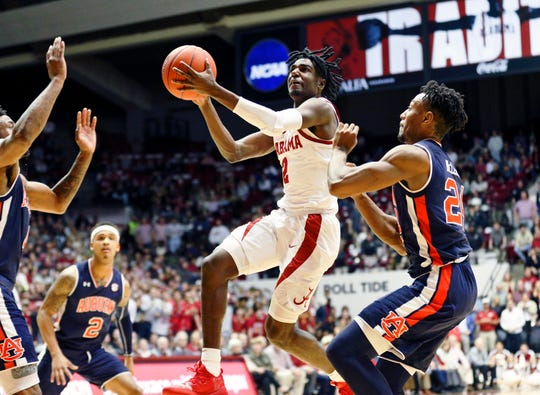 Mar 5, 2019; Tuscaloosa, AL, USA; Alabama Crimson Tide guard Kira Lewis Jr. (2) goes to the basket against Auburn Tigers during the second half at Coleman Coliseum. Mandatory Credit: Marvin Gentry-USA TODAY Sports