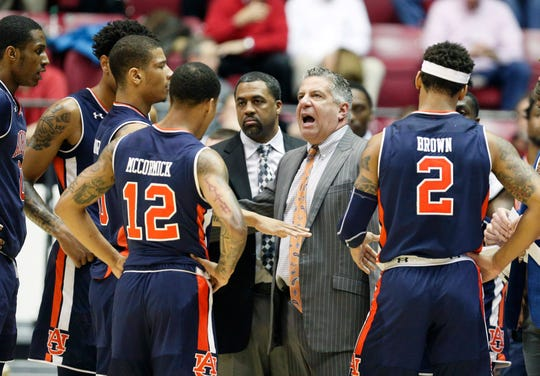 Auburn coach Bruce Pearl talks to his team during a timeout during the first half against Alabama on March 5, 2019, in Tuscaloosa.
