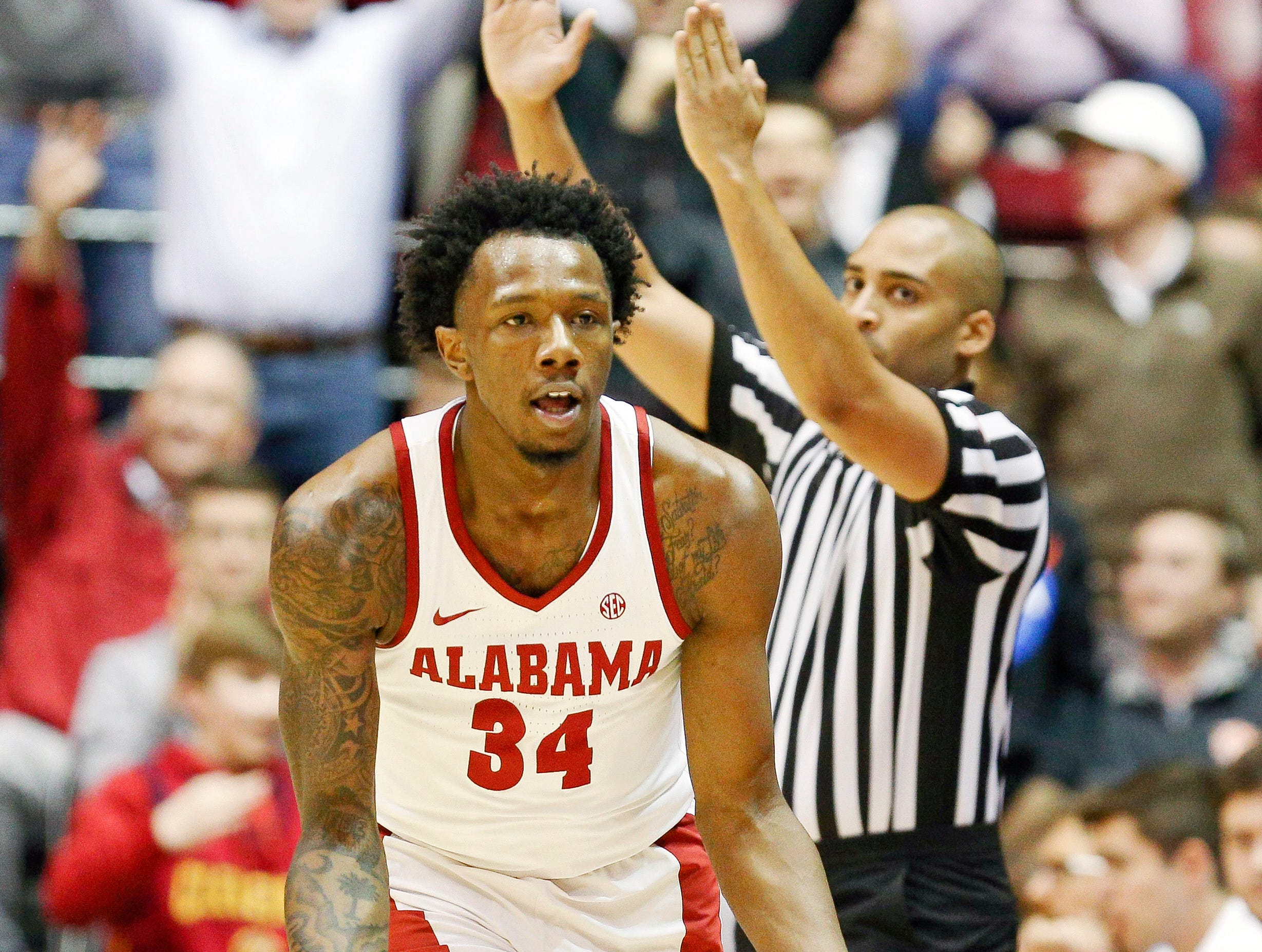 Mar 5, 2019; Tuscaloosa, AL, USA; Alabama Crimson Tide guard Tevin Mack (34) reacts after hitting a 3 pointer during the first half against Auburn Tigers at Coleman Coliseum. Mandatory Credit: Marvin Gentry-USA TODAY Sports