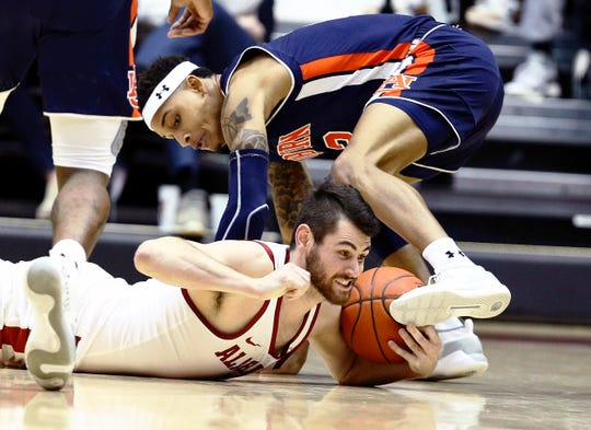 Mar 5, 2019; Tuscaloosa, AL, USA; Alabama Crimson Tide guard Riley Norris (1) and Auburn Tigers forward Danjel Purifoy (3) struggle for the ball during the second half at Coleman Coliseum. Mandatory Credit: Marvin Gentry-USA TODAY Sports