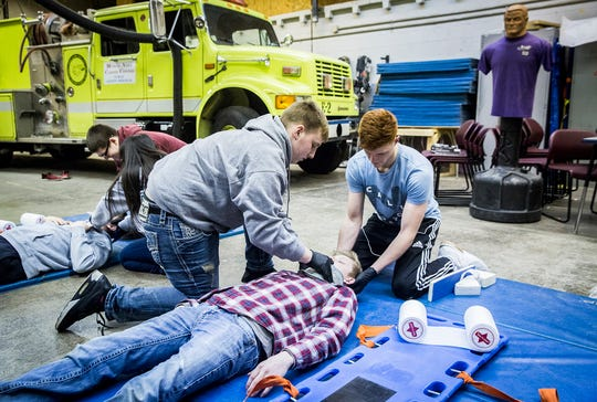 Students work on firefighter skills during a public safety class at the Muncie Area Career Center Wednesday.