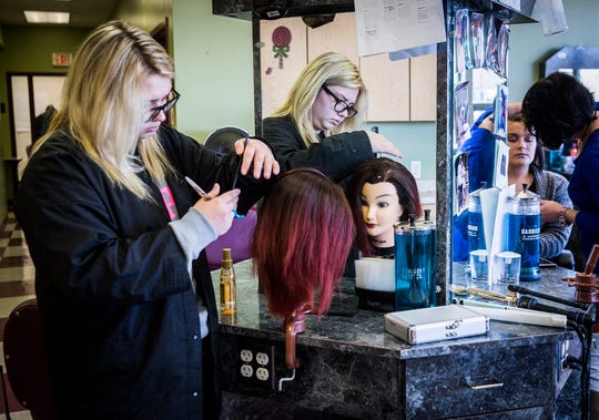 Cosmetology students practice their skills at the Muncie Area Career Center Wednesday.
