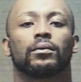 Police: Convicted dealer had 70 grams of coke, guns, bulletproof vest