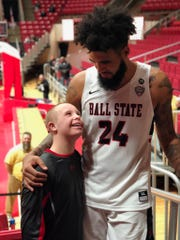 Trey Moses greets Luke Vormohr after a Ball State basketball game.