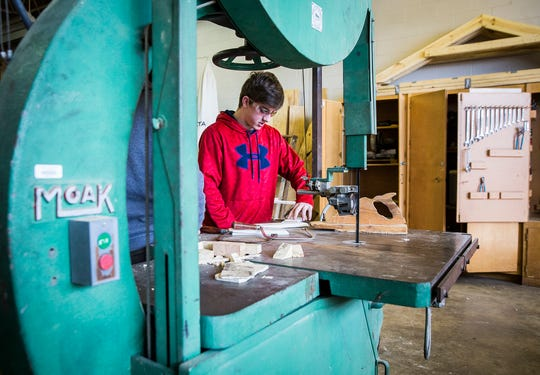 Students in a building trades class piece together a shed at the Muncie Area Career Center  Wednesday afternoon.
