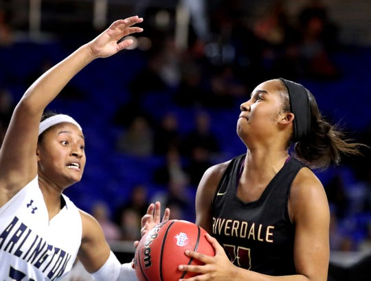 Riverdale's Aislynn Hayes (11) goes up for a shot as Arlington's Karlee Bates (21) guards her during the quarterfinal round of the TSSAA Div. 1 Class AAA Girls State Tournament, on Wednesday, March 6, 2019, at Murphy Center in Murfreesboro, Tenn.