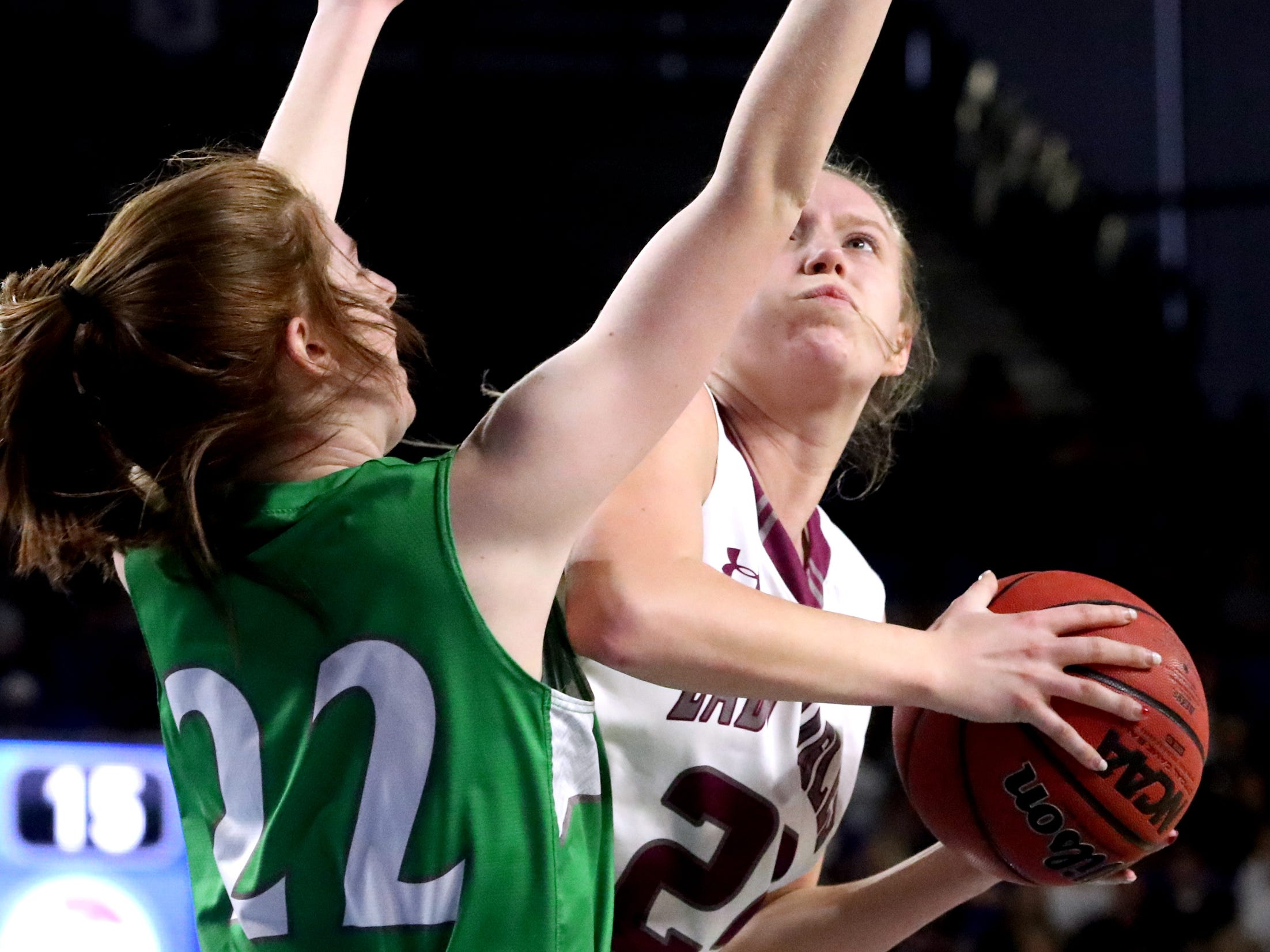 Midway's Macy Young (24) shoots the ball as Midway's Emily Cawood (22) guards her during the quarterfinal round of the TSSAA Div. 1 Class A Girls State Tournament, on Thursday, March 7, 2019, at Murphy Center in Murfreesboro, Tenn.