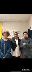 La Vergne High School student Kerolos Girgis, right, spearheaded efforts to buy gifts to cheer up fellow classmate, Azie Robinson, left, in the classroom of biology teacher Sonji Newman.