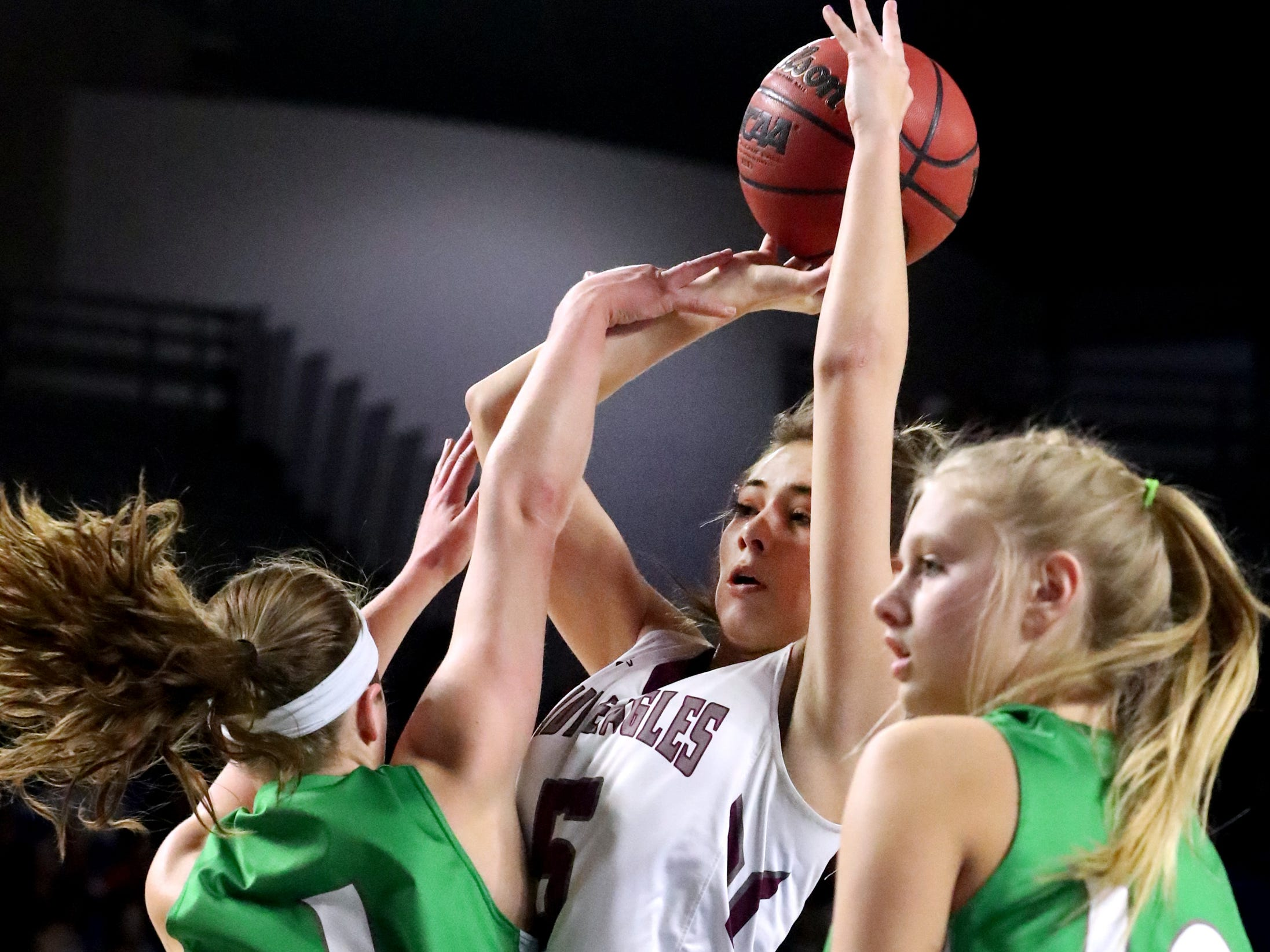 Eagleville's Elizabeth Thompson (5) shoots the ball between Midway's Caitlyn Ross (1) and Heaven Prinzi (10) during the quarterfinal round of the TSSAA Div. 1 Class A Girls State Tournament, on Thursday, March 7, 2019, at Murphy Center in Murfreesboro, Tenn.