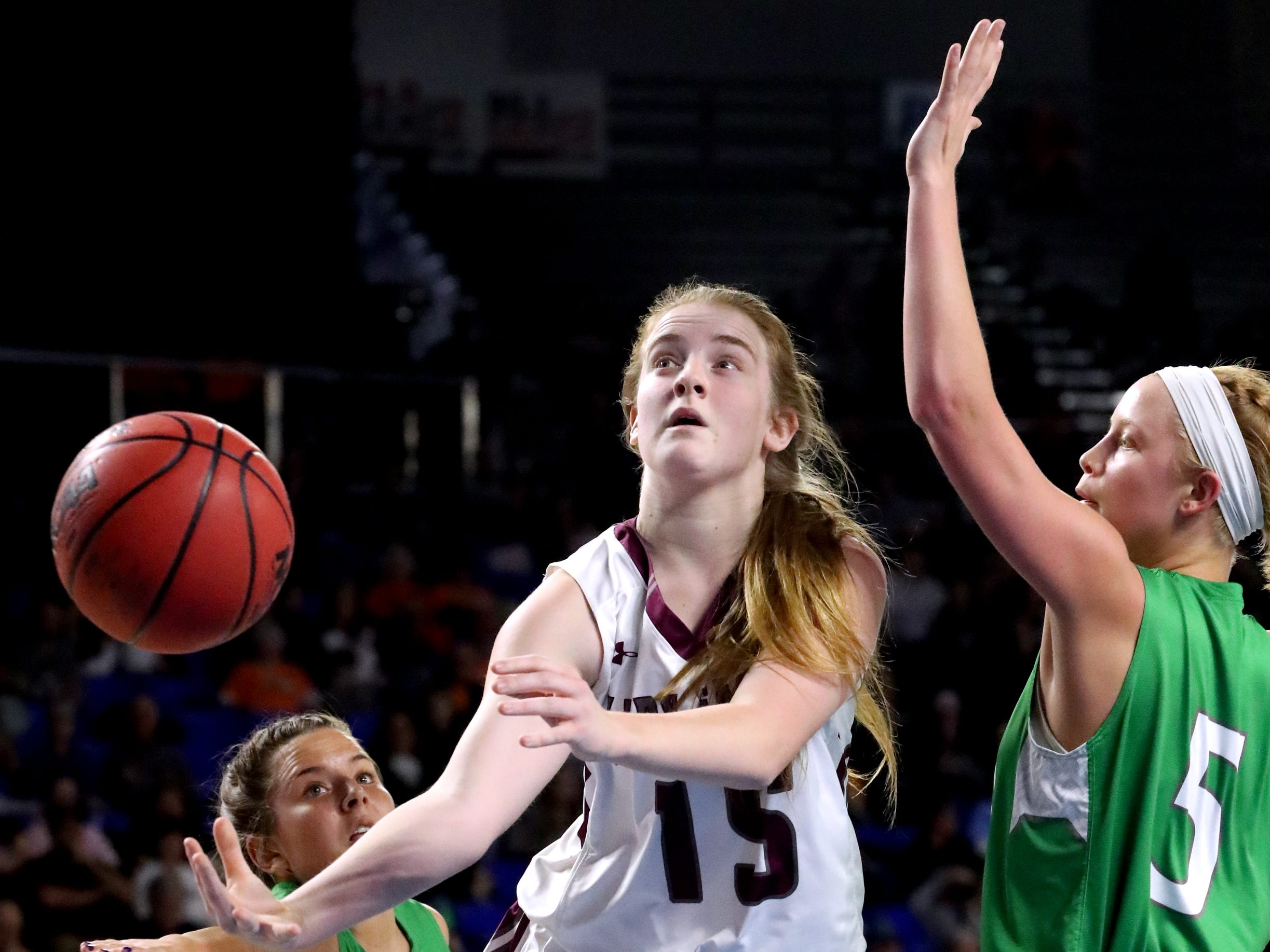 Eagleville's Makayla Moates (15) shoots the ball as Midway's Paige Bacon (5) guards her during the quarterfinal round of the TSSAA Div. 1 Class A Girls State Tournament, on Thursday, March 7, 2019, at Murphy Center in Murfreesboro, Tenn.