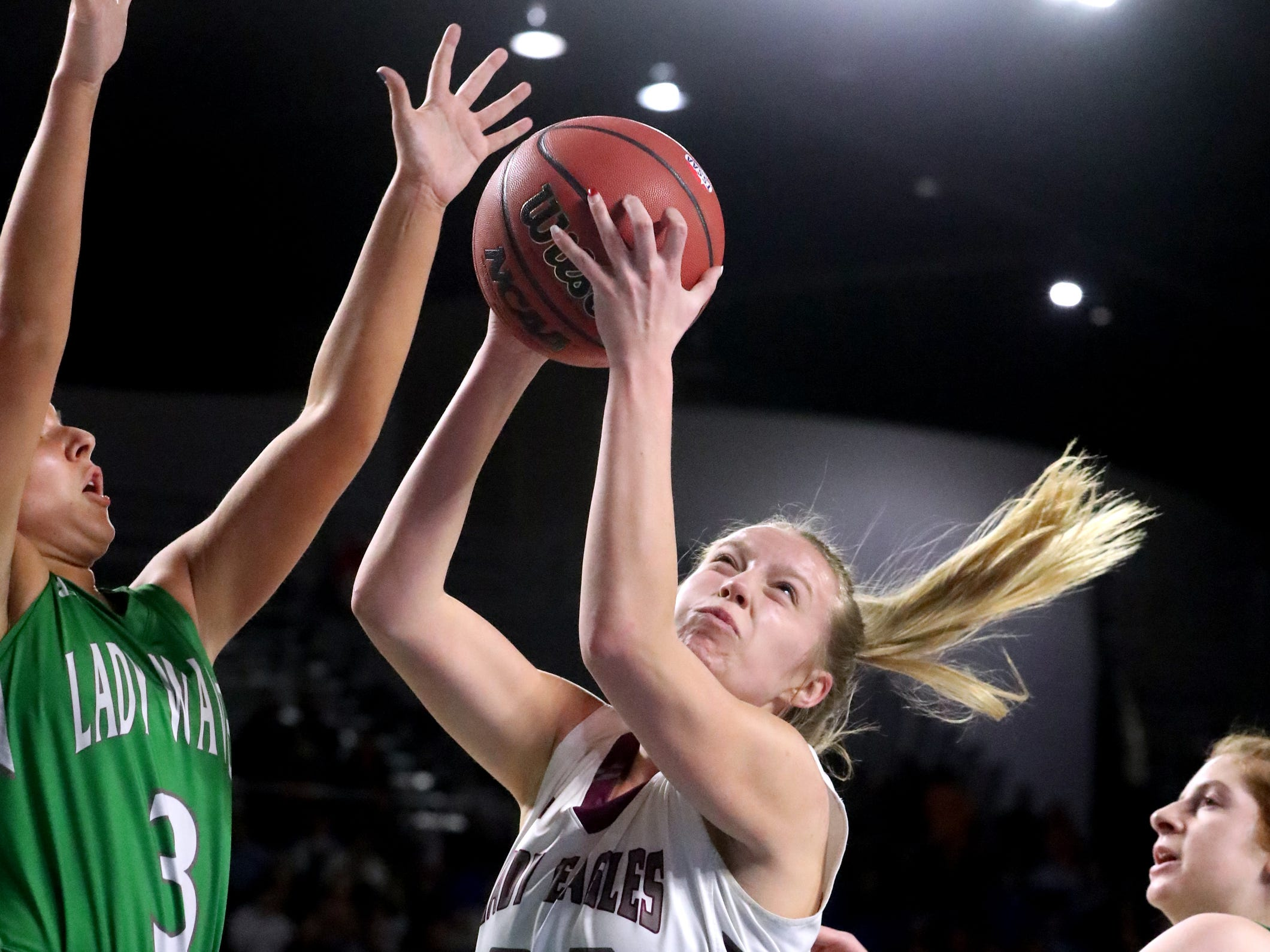 Midway's Macy Young (24) goes up for a shot as Midway's Rebecca Lemasters (3) guards her during the quarterfinal round of the TSSAA Div. 1 Class A Girls State Tournament, on Thursday, March 7, 2019, at Murphy Center in Murfreesboro, Tenn.