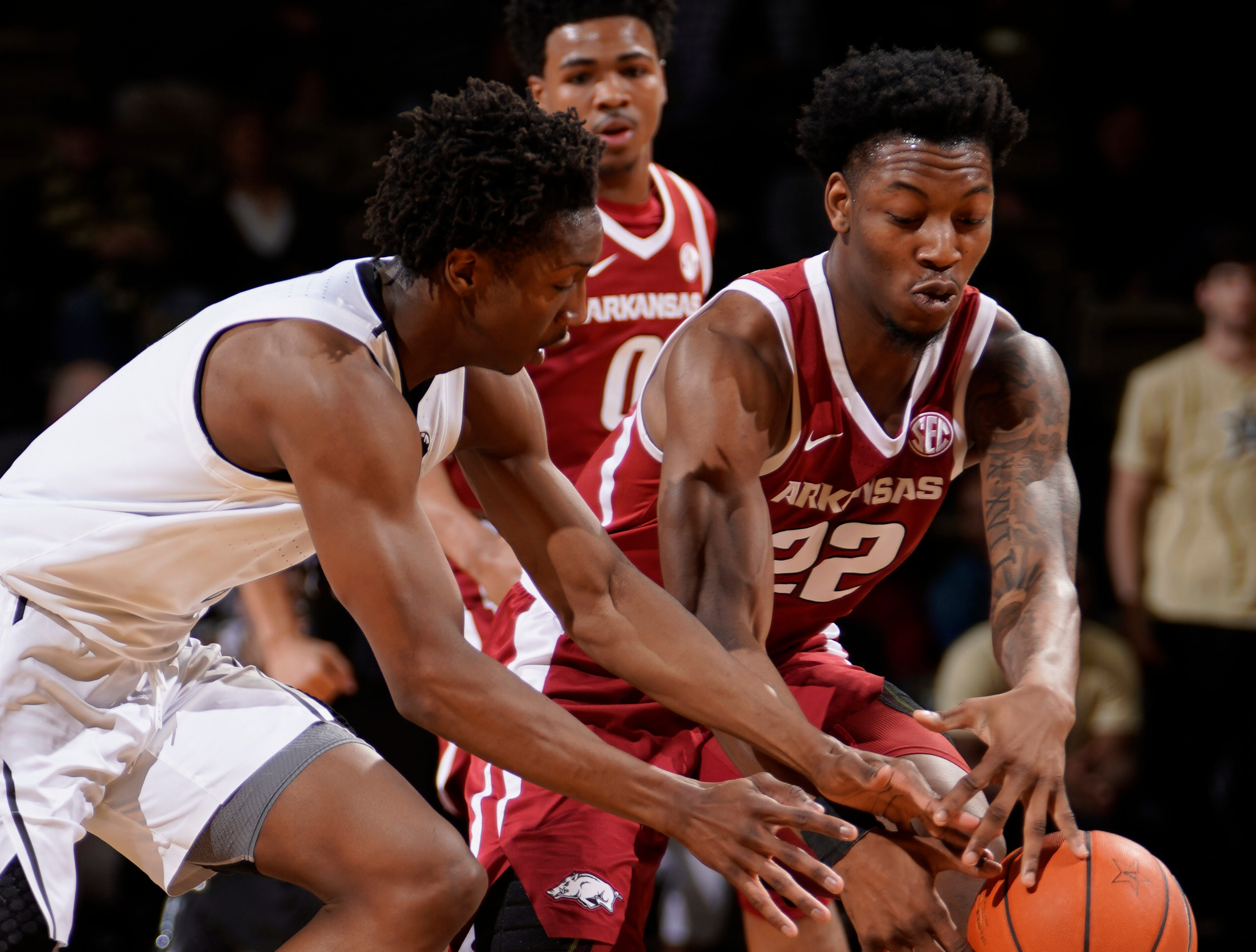 Vanderbilt guard Saben Lee (0) tries to take the ball from Arkansas forward Gabe Osabuohien (22) during the first half at Memorial Gym Wednesday, March 6, 2019 in Nashville, Tenn.