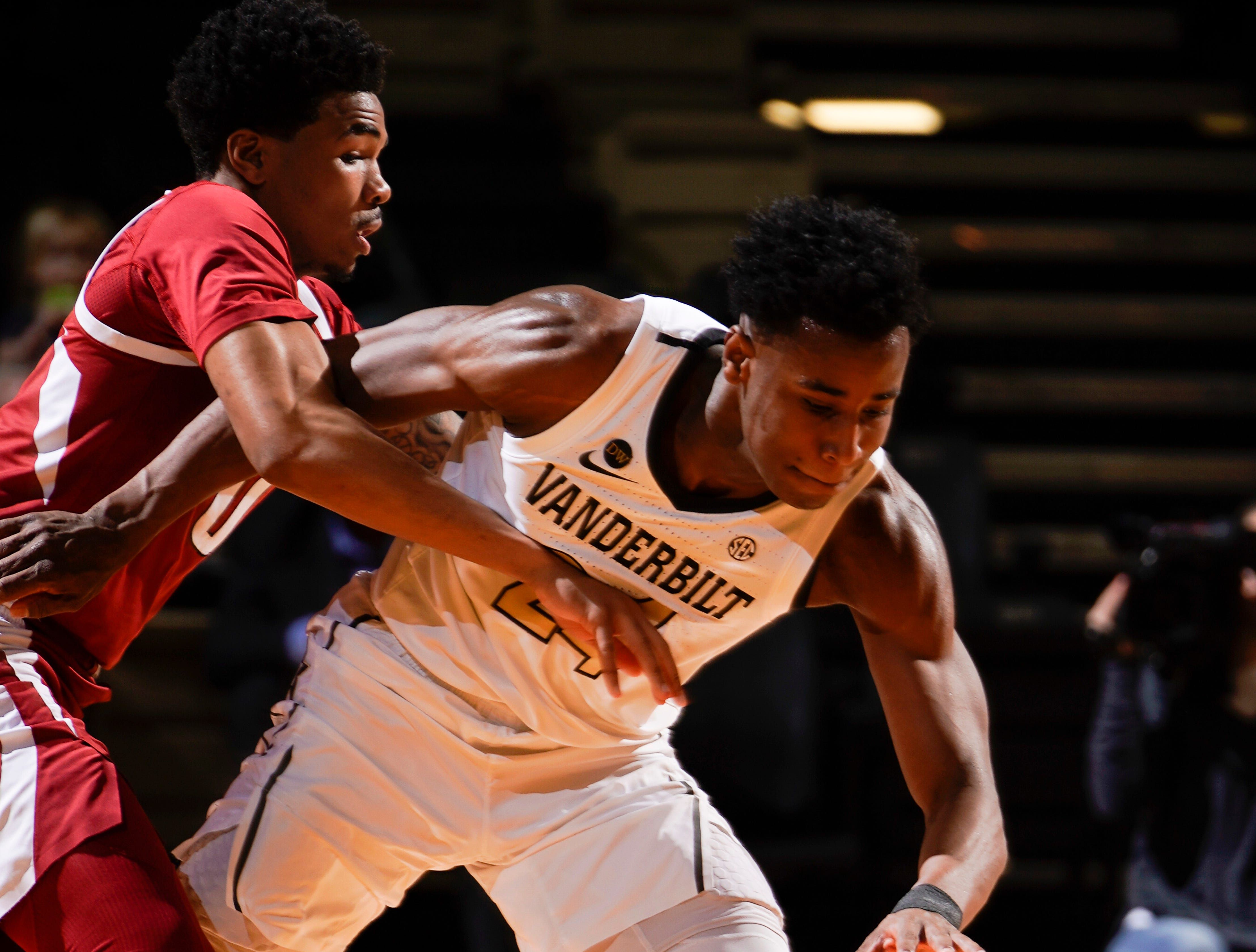 Vanderbilt forward Aaron Nesmith (24) steals the ball away from Arkansas guard Desi Sills (0) during the first half at Memorial Gym Wednesday, March 6, 2019 in Nashville, Tenn.