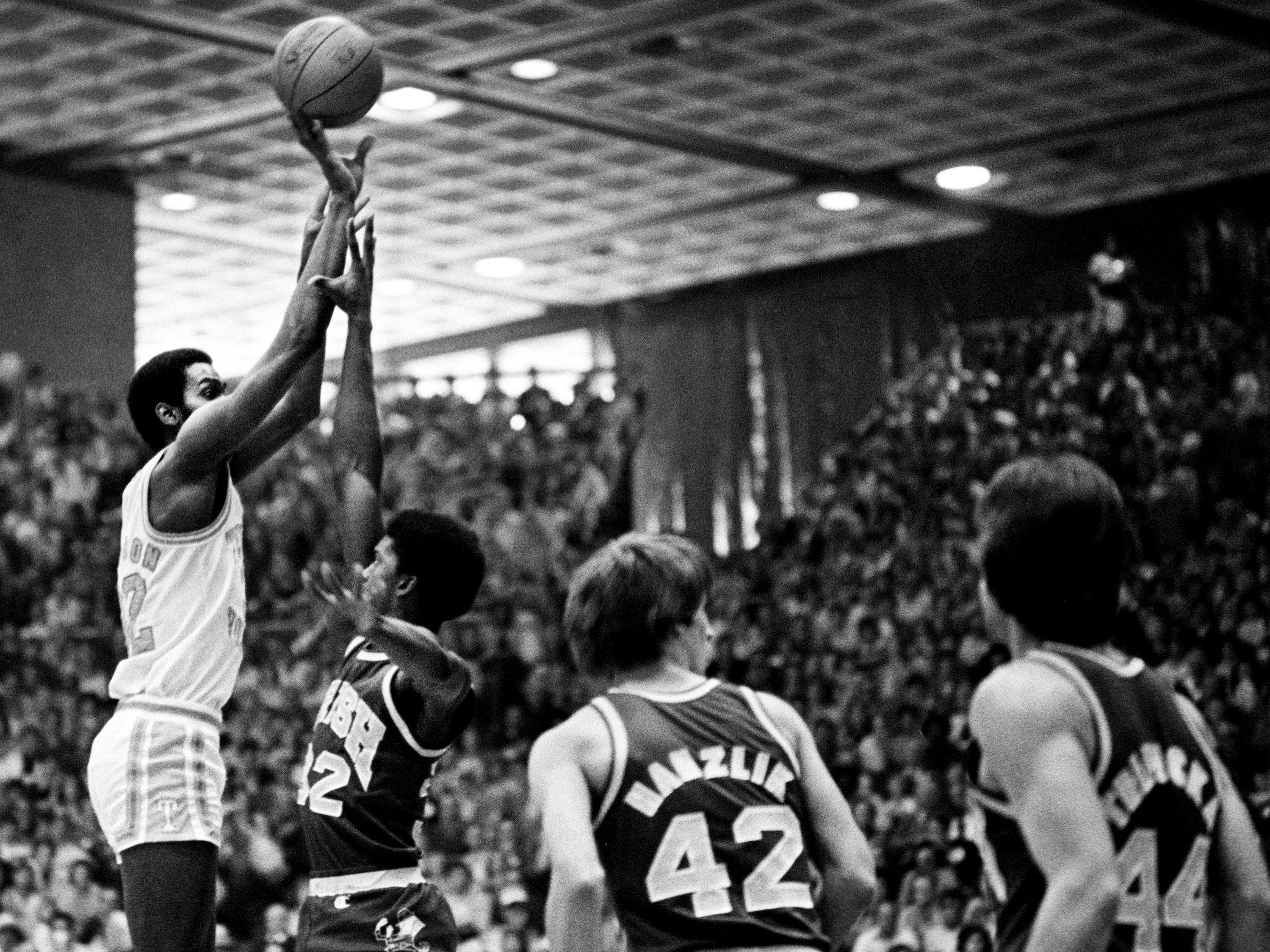 Tennessee junior Reggie Johnson, left, takes a shot against Notre Dame during the NCAA Mideast Regional tournament at MTSU's Murphy Center in Murfreesboro on March 11, 1979. Tennessee was knocked out the tournament with a 73-67 loss to Notre Dame.