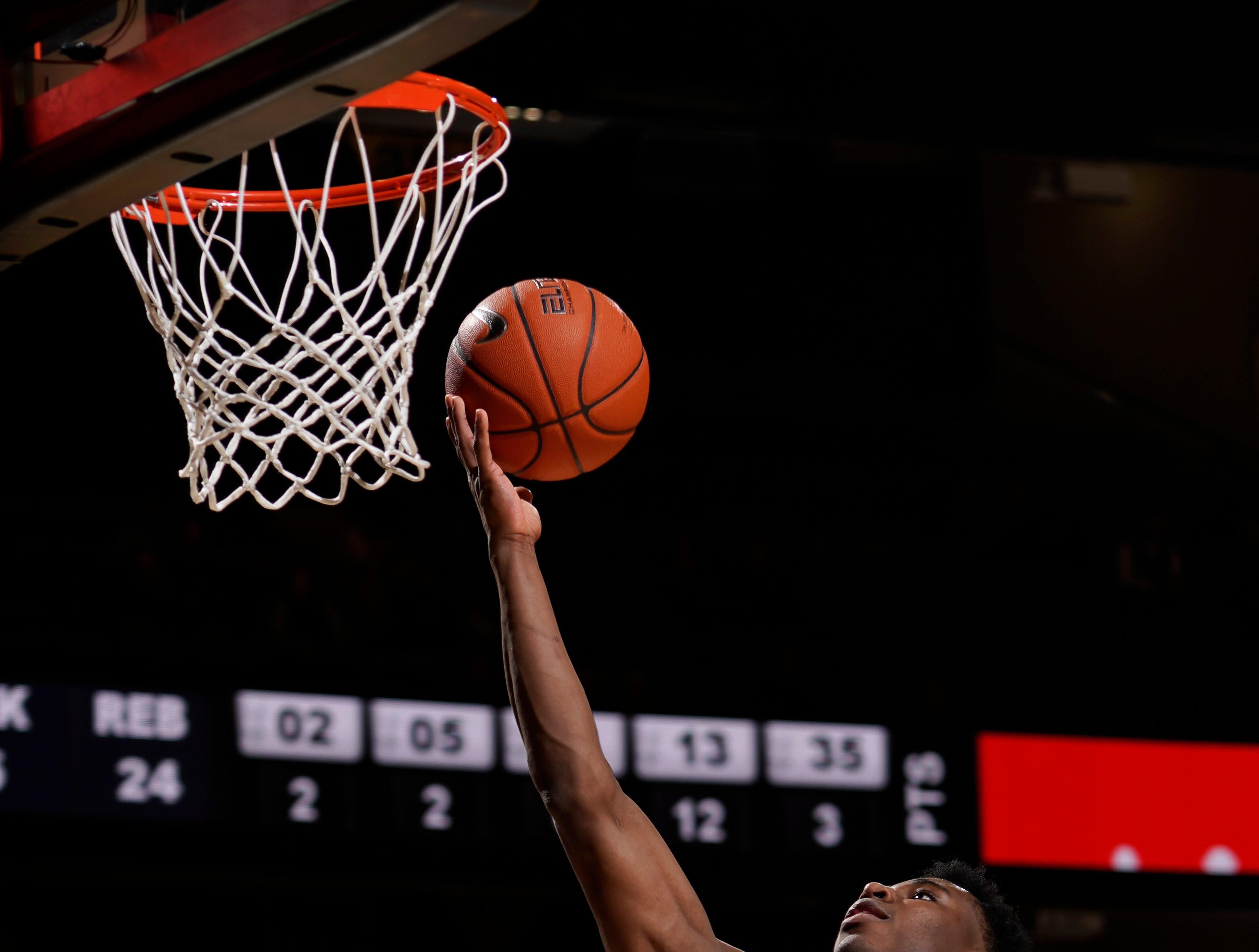 Vanderbilt forward Aaron Nesmith (24) shoots a basket past the Arkansas defense during the second half at Memorial Gym Wednesday, March 6, 2019 in Nashville, Tenn.