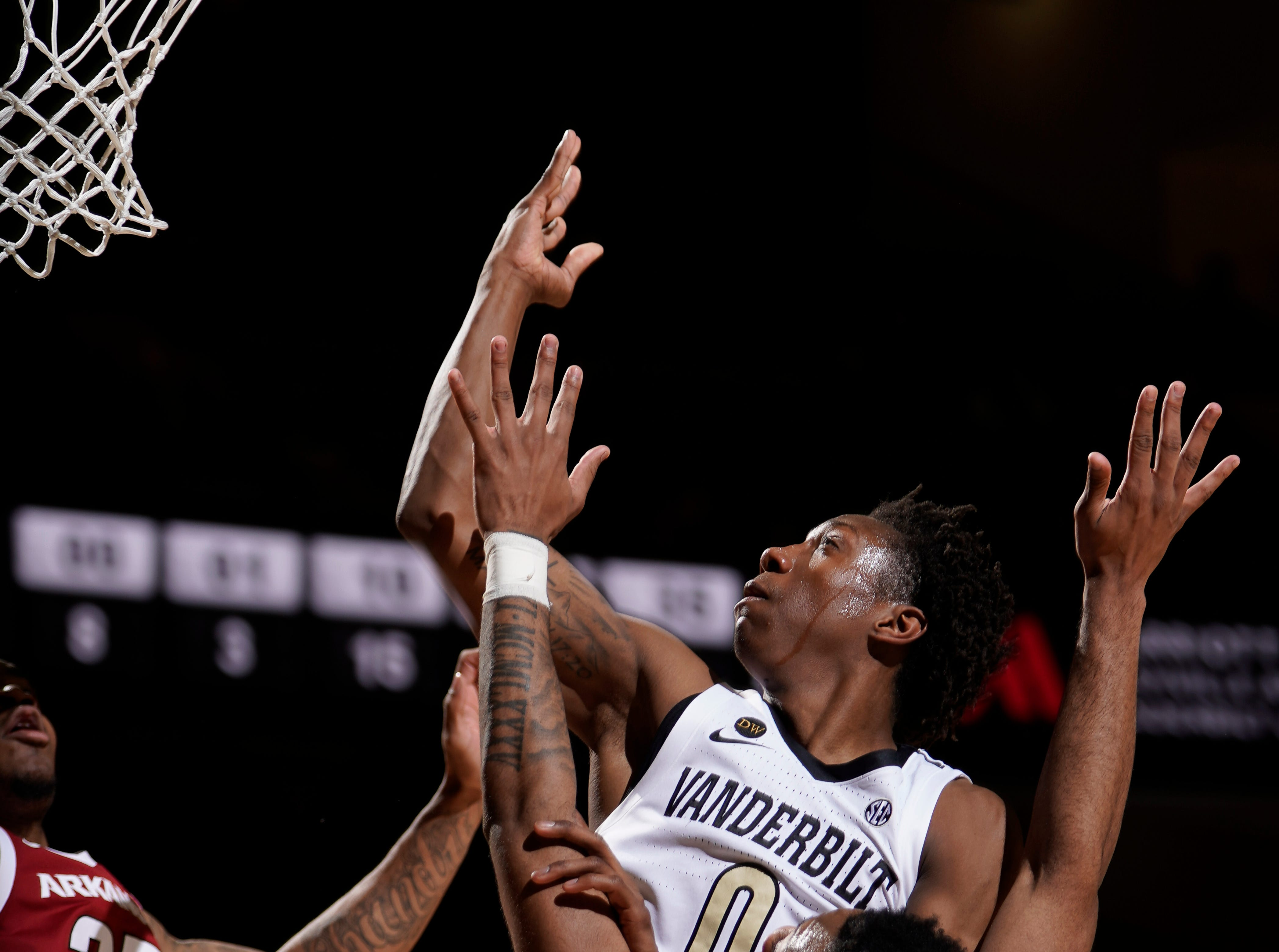 Vanderbilt guard Saben Lee (0) shoots over Arkansas guard Keyshawn Embery-Simpson (11) and forward Reggie Chaney (35) during the second half at Memorial Gym Wednesday, March 6, 2019 in Nashville, Tenn.