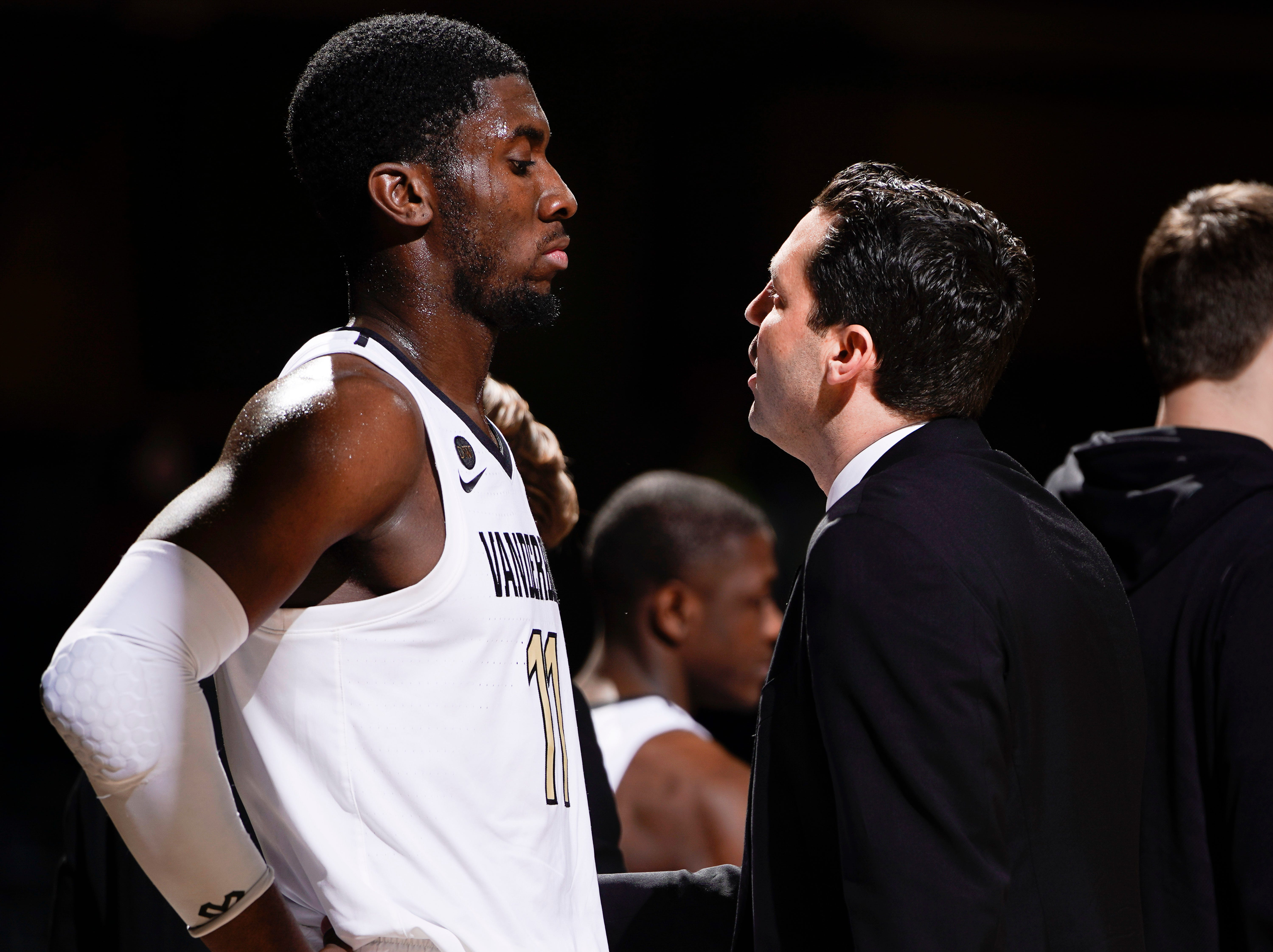 Vanderbilt forward Simisola Shittu (11) looks at head coach Bryce Drew as he gives him instructions during the second half of their game against Arkansas at Memorial Gym Wednesday, March 6, 2019 in Nashville, Tenn.