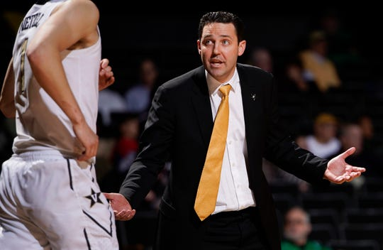 Vanderbilt head coach Bryce Drew talks with forward Yanni Wetzell (1) as he takes the court during their 48 to 84 loss against Arkansas at Memorial Gym Wednesday, March 6, 2019 in Nashville, Tenn.