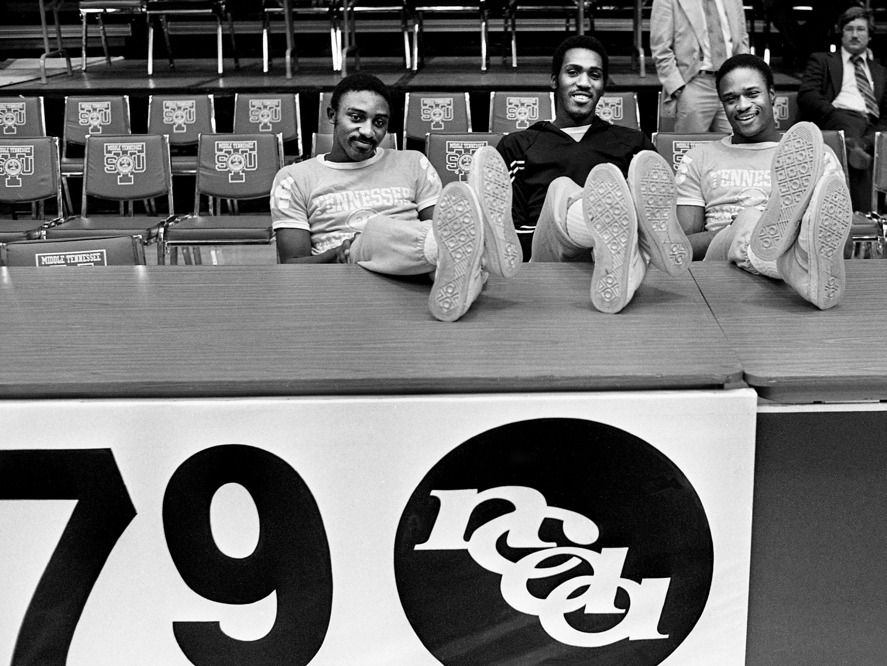 The University of Tennessee Vols basketball team, which includes guard Johnny Darden, left, forward Reggie Johnson and forward Terry Crosby, have a lot of sole heading into the NCAA Mideast Regional competition at the Murphy Center at MTSU in Murfreesboro. They are waiting for the start of practice March 8, 1979.