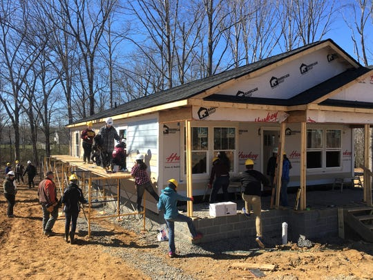 Volunteers with Habitat for Humanity Williamson-Maury work on a house in the upcoming Willow Crest subdivision in Fairview.
