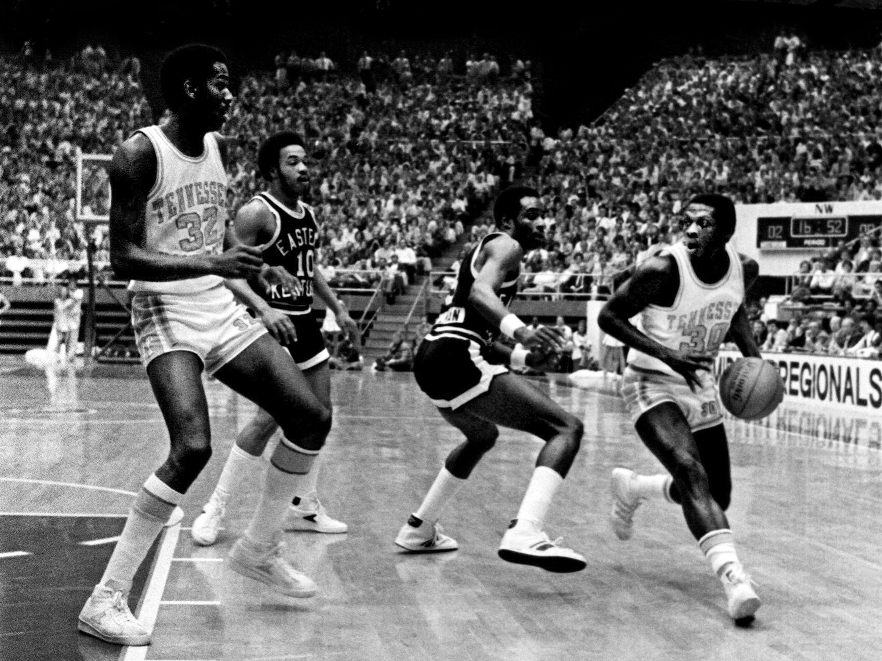 Tennessee guard Gary Carter (30) looks to pass to teammate Reggie Johnson (32) as they defeat Eastern Kentucky 97-81 in the NCAA Mideast Regional tournament at MTSU's Murphy Center in Murfreesboro on March 9, 1979.
