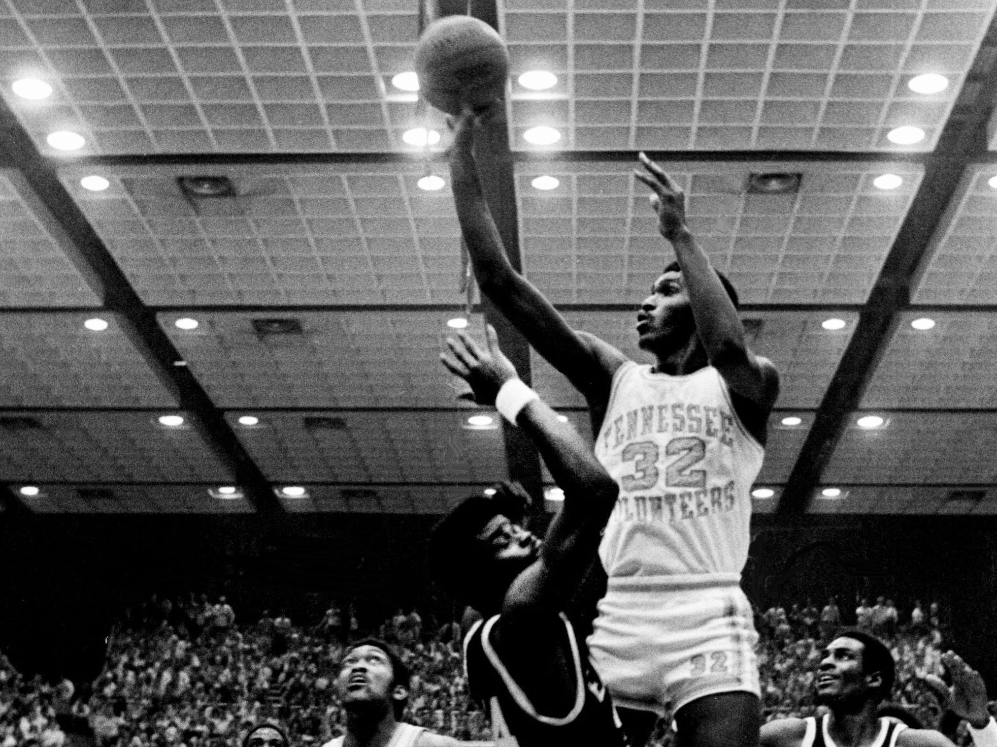 Tennessee junior forward Reggie Johnson (32) shoots for two as the Vols defeats Eastern Kentucky 97-81 in the NCAA Mideast Regional tournament at MTSU's Murphy Center in Murfreesboro on March 9, 1979.
