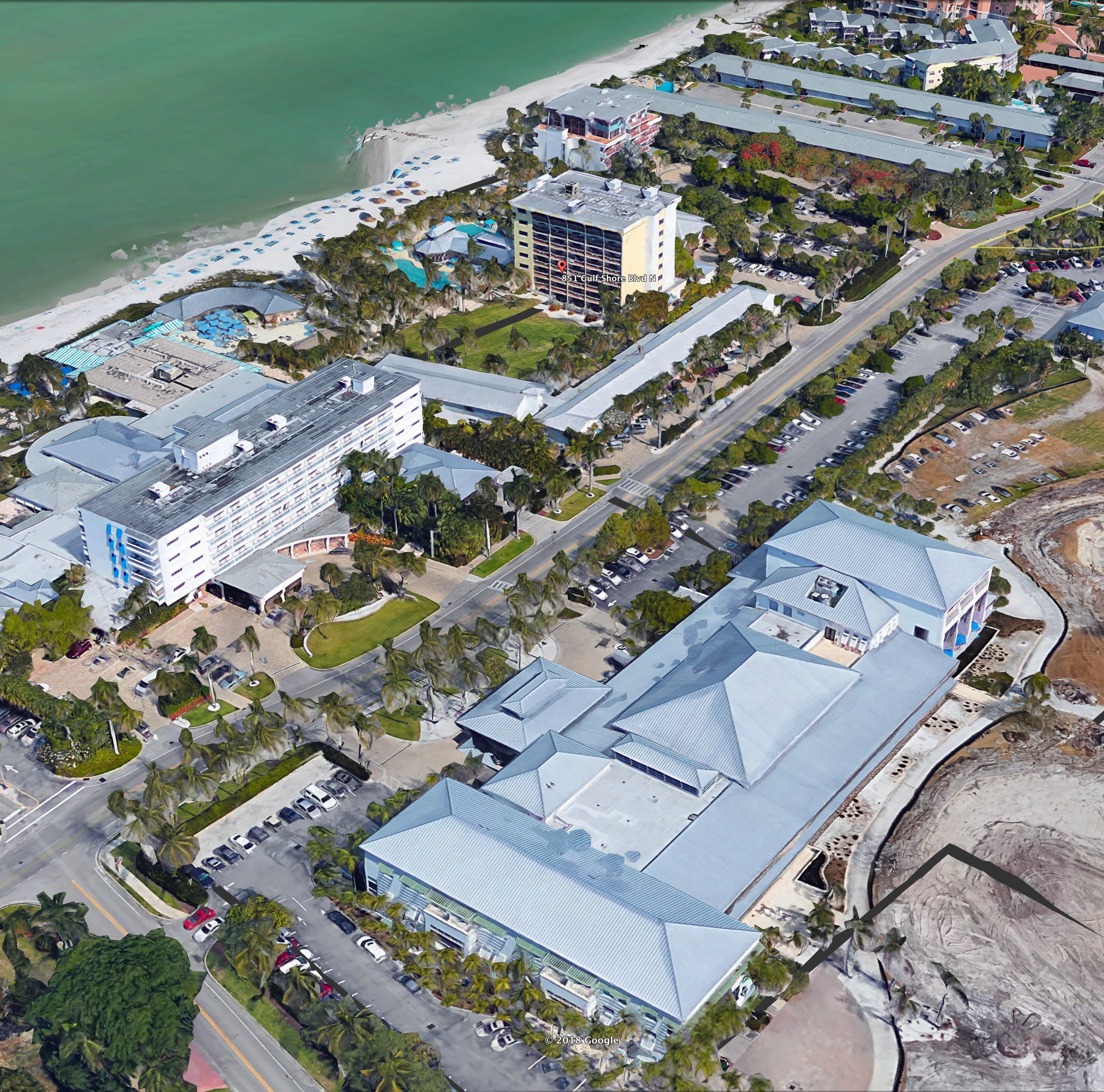 What changes has company made to Naples Beach Hotel redevelopment plan?