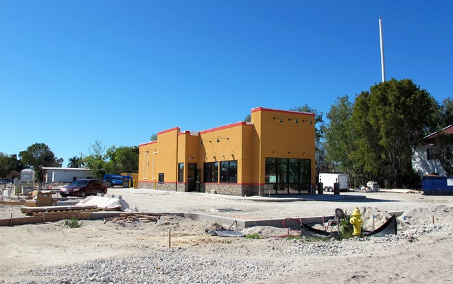 The new Popeyes Louisiana Kitchen drive-thru nears completion on Collier Boulevard in Golden Gate.