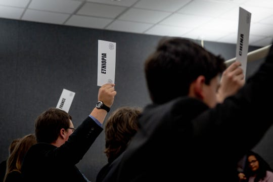 Students vote at the Southwest Florida Model United Nations Conference held at Florida Gulf Coast University on Thursday, March 7, 2019.