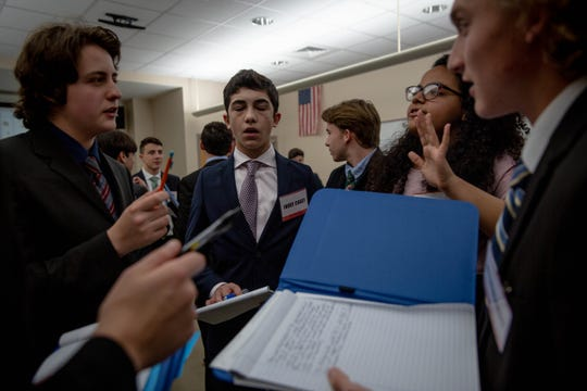 Students in the United Nations Security Council discuss the situation in Syria with one another at the Southwest Florida Model United Nations Conference held at Florida Gulf Coast University on Thursday, March 7, 2019.