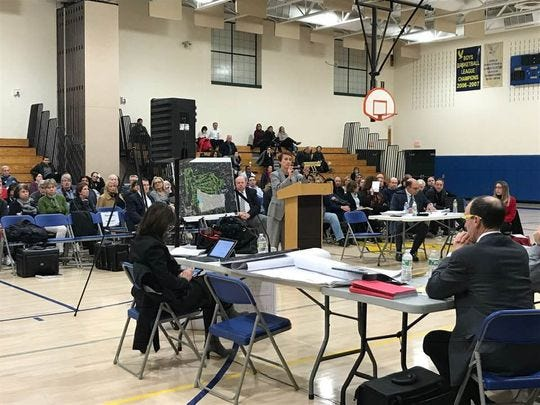 A public hearing earlier this year on the 249-unit housing development that is proposed for the Edgewood Country Club in River Vale. A decision to allow the project to by built has not yet been made.