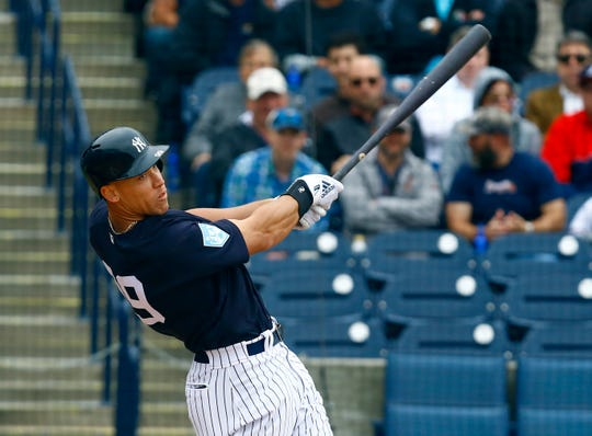 Mar 5, 2019; Tampa, FL, USA; New York Yankees right fielder Aaron Judge (99) hits a double during the fourth  inning of a game against the Atlanta Braves at George M. Steinbrenner Field.