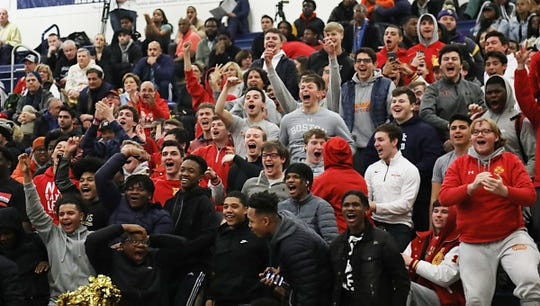 Bergen Catholic fans react as their team scores their 100th point of the game.