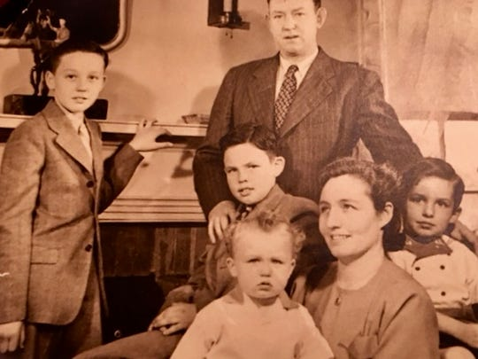 Julia O'Neill with her husband Michael, and her four sons, from left, Nicholas, Michael, Patrick and Kevin.