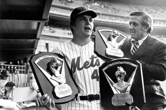 New York Mets pitcher Tom Seaver, left,  receives his third Cy Young Award from Jack Lang, secretary-treasurer of the Baseball Writers Association, in New York  on May 7, 1976.