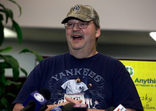 Mike Weirsky speaks during a news conference Thursday, March 7, 2019 in Trenton, NJ. Weirsky, a New Jersey man who almost forgot his $273 million jackpot-winning Mega Millions lottery ticket at the store where he bought it says he's going to reward whoever returned it. (AP Photo/Jacqueline Larma)