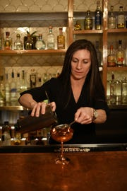 Bar Manager Lauren Tarzian makes a cocktail at Somos restaurant in North Arlington, New Jersey, on March 6, 2019.
