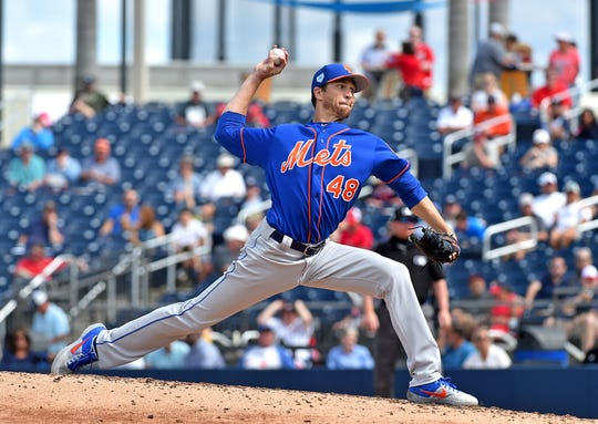 Mar 7, 2019; West Palm Beach, FL, USA; New York Mets starting pitcher Jacob deGrom (48) delivers a pitch against the Washington Nationals during a spring training game at FITTEAM Ballpark of the Palm Beaches.