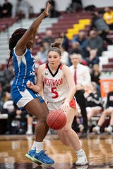 Westwood vs Lincoln in girls basketball Group 2 semifinal at Union High School on Thursday, March 7, 2019. WW #5 Hannah Jackson tries to get past L #2 Alaisha Mumford.