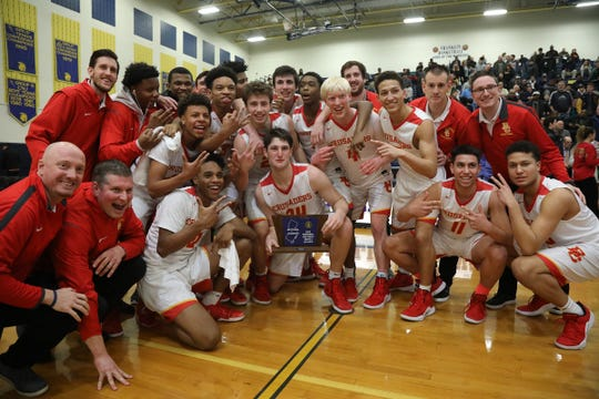 Bergen Catholic with their trophy after their 100-63 win over St. Joseph