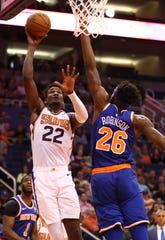 Mar 6, 2019; Phoenix, AZ, USA; Phoenix Suns center Deandre Ayton (left) drives to the basket against New York Knicks forward Noah Vonleh in the first half at Talking Stick Resort Arena.
